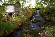Free Wooden House Near The Waterfall Royalty Free Stock Photography - 18529577