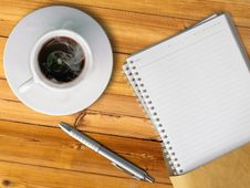 White Cup Of Hot Coffee And Blank Page Note Book Stock Photo
