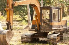Free Digger In The Jungle Clearing Trees Royalty Free Stock Photography - 18533747