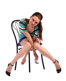 Free Girl In Stripy Blue Dress On Stool Smiling. Royalty Free Stock Photography - 18536227