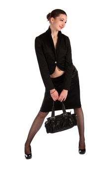 Free Girl In Black Suit Holds Bag. Royalty Free Stock Photos - 18536798