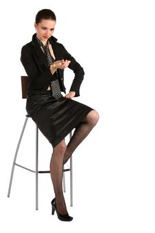 Girl In Black Suit Looks At Pencil. Royalty Free Stock Images