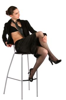 Free Girl In Black Suit Posing On Stool. Stock Photography - 18537182