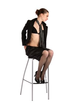 Free Girl In Black Suit Sits On Stool Posing. Royalty Free Stock Image - 18537196