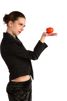 Free Girl In Black Suit Looks At Tomato. Stock Photography - 18537322