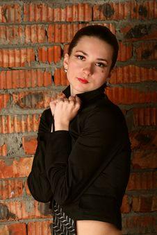 Girl In Black Suit Posing At Brickwall. Stock Image