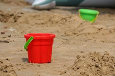 Free Red Bucket On Sand Stock Images - 18538514