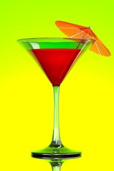 Red Tropical Martini Cocktail With Orange Umbrella Royalty Free Stock Photos