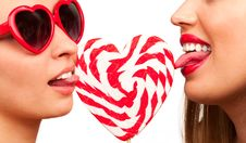 Sexy Women With Heart Shaped Lollipop Stock Images
