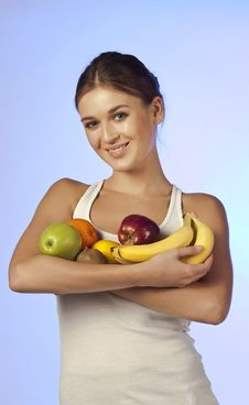 Free Young Beautiful Brunette Is Holding Fruit Royalty Free Stock Image - 18541786