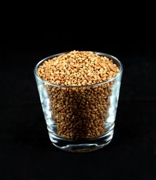 Free Buckwheat Millet Kernels In A Cup On Black Stock Photo - 18542010