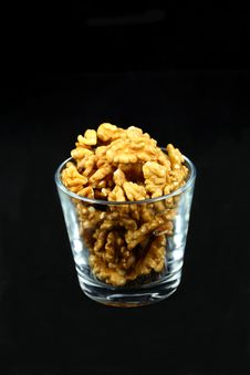 Free Walnut Kernels In A Cup On Black Royalty Free Stock Images - 18542019