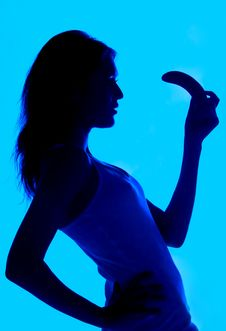 Free Silhouette Of The Woman With A Banana In A Hand Stock Photos - 18542043