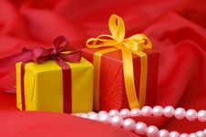 Free Box With A Gift On A Red Fabric Royalty Free Stock Image - 18543856