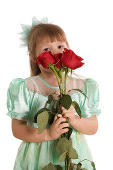 The Little Girl With A Bouquet Of Roses Stock Photo