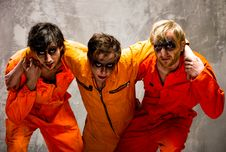 Free Three Guys In Orange Uniforms Stock Images - 18544834