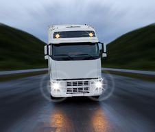 Motion Of White Truck Stock Image