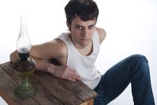 Free Portrait Of A Young Man Near A Wooden Stool Royalty Free Stock Image - 18547286