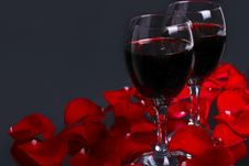 Free Two Glasses Of Wine With Petals Of Rose Stock Photo - 18547600