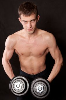 Free Man Lifting Dumbbell Against Black Background Stock Image - 18548321