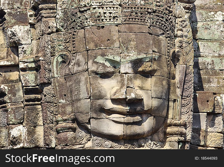 Stone head on towers of Bayon