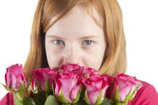Free Young Girl Is Smelling At Beautiful Pink Roses Stock Image - 18553991