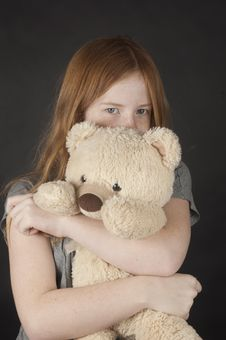 Free Young Girl Is Cuddling With A Teddybear Stock Photo - 18554090