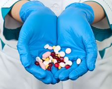 Free Drugs In The Hands Of A Doctor Royalty Free Stock Photography - 18555017