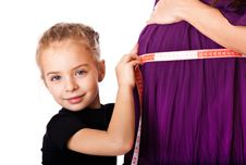 Free A Girl Measures The Belly Of Her Mother Stock Image - 18555721