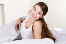 Free Lovely Young Woman Lying In Bed Stock Image - 18561321