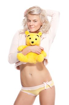 Free Blond Woman With Yelow Bear Royalty Free Stock Photography - 18567777