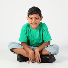 Free Happy Young School Boy 10 Sitting On The Floor Stock Images - 18568034