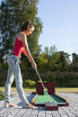 Free Attractive Young Woman Putting Golf Ball On Green Stock Photos - 18576133