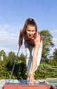 Free Attractive Young Woman Putting Golf Ball On Green Stock Images - 18576254
