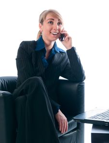 The Businesswoman Speaks By Phone Royalty Free Stock Photography
