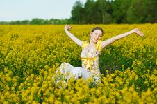 Woman On Yellow Field Stock Photos