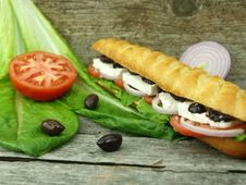 Mediterranean Baguette With Olives Stock Photos