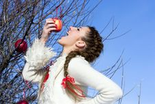 Free Funny Girl Eating Apple Outdoor Stock Photo - 18575640