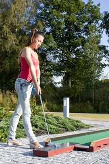 Young Woman Playing Golf In A Country Club Royalty Free Stock Photo