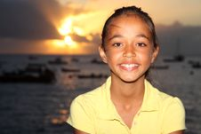 Free Happy Mixed Race School Girl By Seaside At Sunset Stock Photos - 18579443