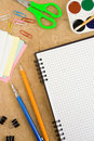 Free School Accessories And Checked Notebook On Wood Royalty Free Stock Photos - 18581528