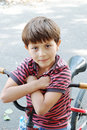 Free The Boy Sitting On A Bicycle Stock Image - 18588271