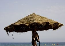 Straw Umbrella Stock Photo