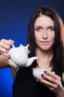 Free Girl Holding Cup Of Tea Stock Images - 18581614