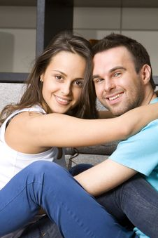 Free Young Couple On A Sofa Royalty Free Stock Image - 18584766