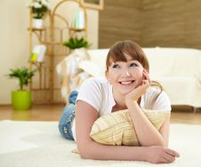 Free Young Woman Relaxing At Home On The Floor Royalty Free Stock Images - 18586669