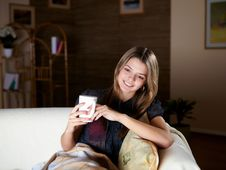 Free Young Girl Drinking Tea At Home Royalty Free Stock Photos - 18586718