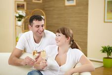 Couple At Home Drinking Champagne Royalty Free Stock Image