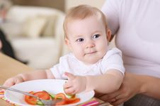 A Young Mother Feeding Her Baby At Home Stock Photography