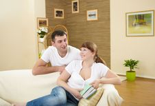 Couple At Home Drinking Champagne Stock Image